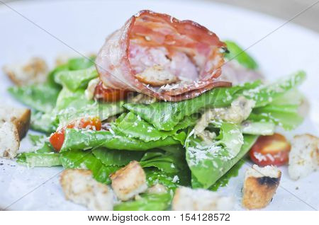 Caesar salad or salad with cos lettuce and ham dish