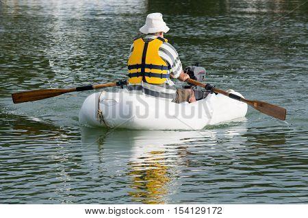 Man Rows Dinghy Boat