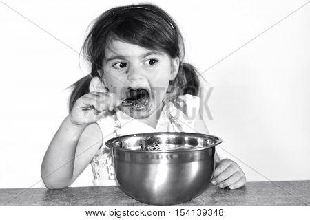 Little Girl Eats Lots Of Chocolate Cream