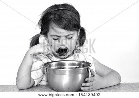 Little Girl Eats Chocolate Cream