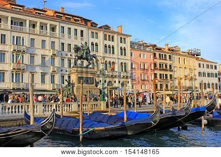 ITALY, VENICE - october 11: tourists walking along the waterfront Riva degli Schiavoni of the Grand Canal and equestrian monument of Victor Emmanuel II, near St. Mark's Square on october 11, 2016 Venice, Italy