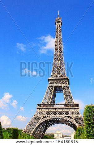 Famous landmark of Paris - Eiffel tower, Champ-de-mars, Paris, France. Summer day