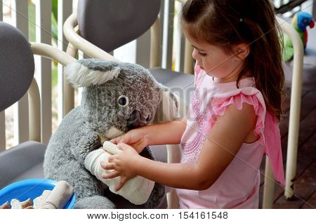 Little Girl Play Pretend To Be Animal Doctor - Veterinary Physician