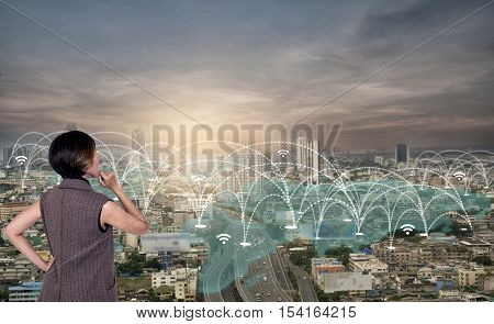 business women looking city scape and social network connection technology. network connection concept