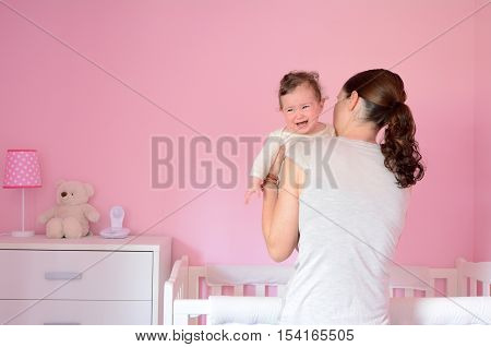Young Mother Puts Her Baby To Sleep