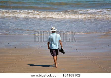 Retired man walks on the beach. concept photo retirement