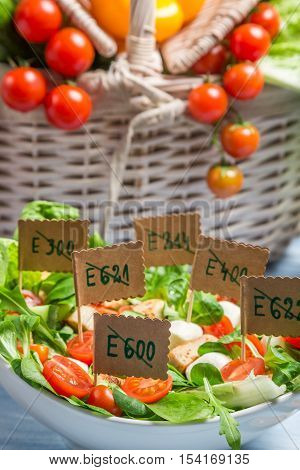 Healthy salad with no preservatives on old wooden table