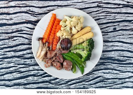 Fried mixed vegetable with chicken hearts-gizzard-liver ,as corn,carrot,peas,cauliflower,block kerry,himeji mushroom and shiitake