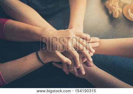 Group of Diverse Hands Together. Business Joining Concept. Group of hipsters joining on business together with vintage filter effect