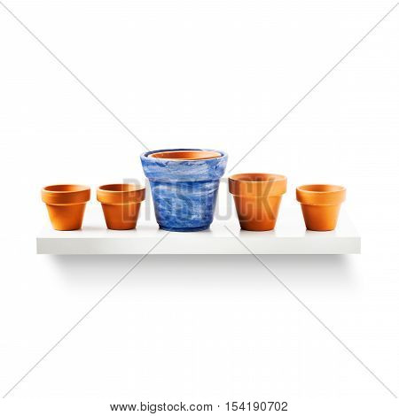 Clay flower pots in a row on shelf isolated on white background. Garden equipment. Group of objects with clipping path