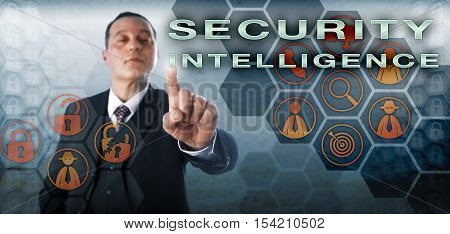 Perky enterprise manager touching SECURITY INTELLIGENCE on an interactive control monitor. Information technology concept and business metaphor for expertise in cyber security and incident response.