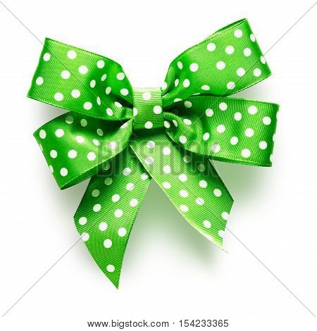 Polka dot green ribbon bow on white background clipping path included