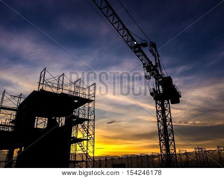 Silhouette Of Scaffolding In The Construction Site Before To Night Time Or Sunset Time. Worker Empty