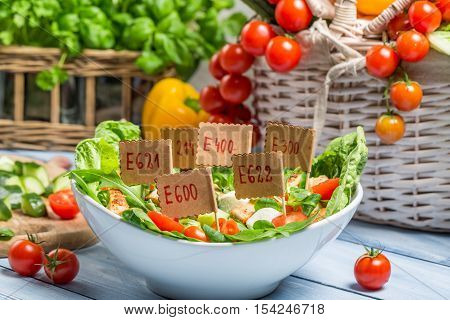 Nice looking food can have preservatives on wooden table