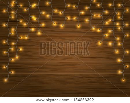 yellow LED Light Glowing Christmas Garland on wooden background. Vector detailed element to decorate the facade or the wall.