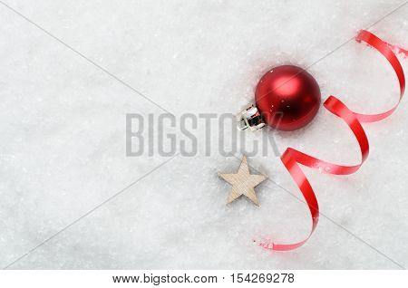 Christmas Snow Background With Red Bauble, Swirl And Star