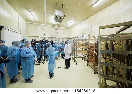 MOSCOW, RUSSIA - MAY 18, 2016: Reporters interview head of the department of trade and services of Moscow Alexey Nemeryuk at plant Russian Fish Factory during Fish Week.