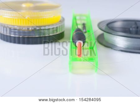 Accessories for fishing. Float fishing line and a box. Focus on the float