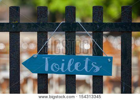 blue toilet, bathroom or restroom sign