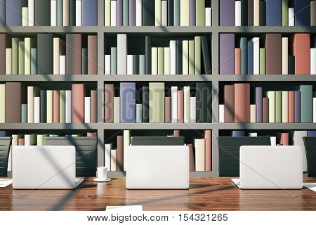 Closeup of library table with laptops coffee cup and daylight on bookcase background. 3D Rendering