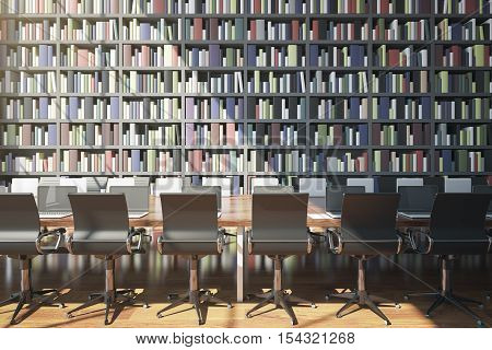 Front view of long wooden table with laptops and chairs on huge bookcase background. Library concept. 3D Rendering