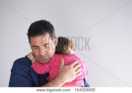Father Hugs His Daughter