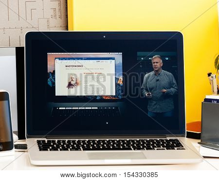 PARIS FRANCE - OCT 28 2016: Apple Computers website on new MacBook Pro Retina with OLED Touch bar in geek creative room showcasing Apple Keynote presentation of Philip Schiller inegration software