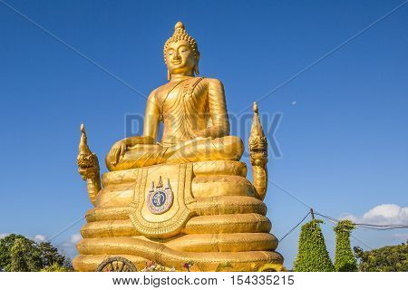 Beautiful golden Buddha inside the temple of popular and largest Bid Buddha in Chalong, Phuket, Thailand. Peace and meditation concept.