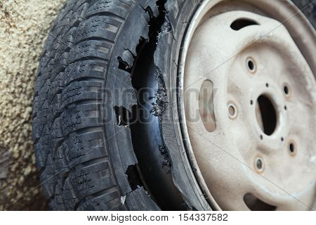 damaged wheel with the destroyed dilapidated tire