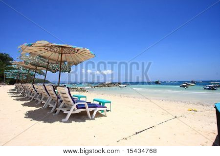 view of chairs and umbrella on the beach