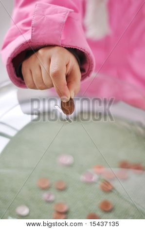 Charity activities, coins under the glass
