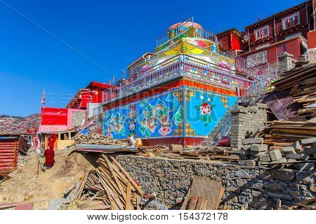 4 MAY 2016 : Buddhist nun walking on the floor in sunshine day at Sanctuary in Larung gar (Buddhist Academy) in Sichuan China