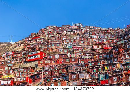 Top view monastery at Larung gar (Buddhist Academy) in sunshine day and background is blue sky Sichuan China