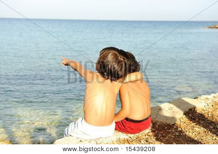 Two little friends on the shore