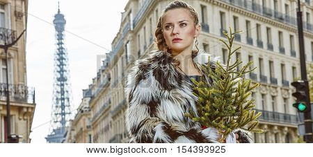 Portrait Of Modern Woman In Paris, France Looking Into Distance