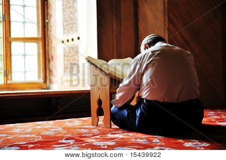 Prayer in mosque, reading Koran