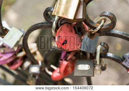 Padlock in combination with ropes threads and scraps of fabric. Boho-style. The symbol of matrimony and weddings.