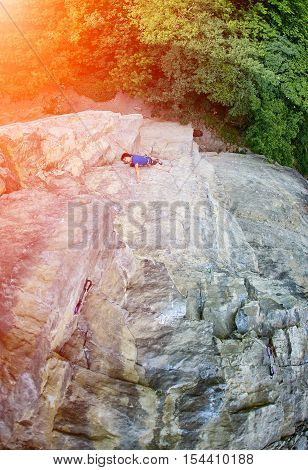 male rock climber. rock climber climbs on a rocky wall.