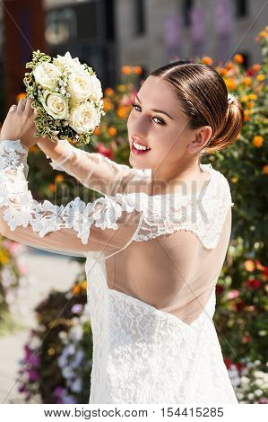Gorgeous young bride getting ready to throw her bouquet