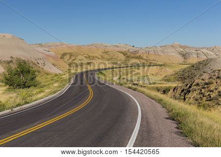 A road curving in the badlands of South Dakota.