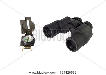 compass and black binoculars on a white background isolated closeup