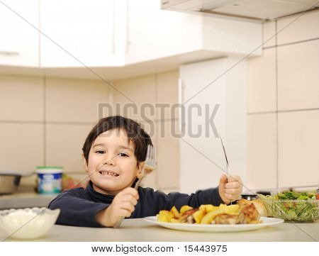 Kid taking lunch in the kitchen
