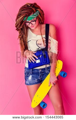 Portrait Of A Young Girl With Skateboard