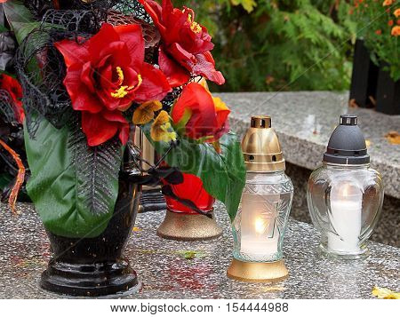 Flowers, light and memory. Lodz, Poland. Flowers and light candles, a symbol of Polish memory of 1 November for those who have passed away.