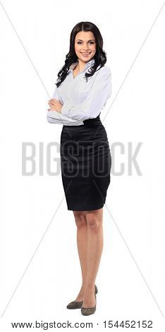 Full length portrait of a beautiful business woman standing with hands folded over white background