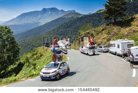 Col D'AspinFrance- July 15 2015: Le Gaulois Caravan during the passing of the Publicity Caravan on the Col d'Aspin in Pyerenees Mountains in the stage 11 of Le Tour de France 2015.Le Gaulois is an important French producer of poultry meat products.