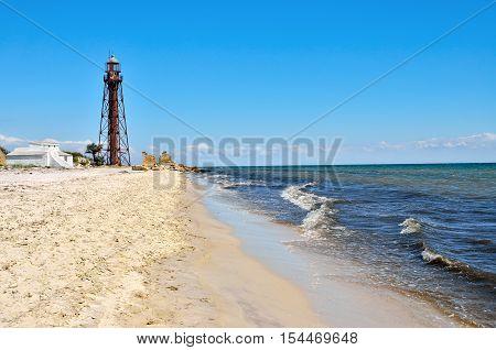 Old Lighthouse On The Beach Near The Sea. Lighthouse On The Coast Of The Island Dzharylgach.