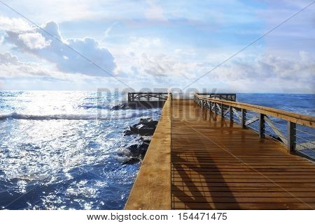 wooden landing blue sea and sky background at Ostia Lido Rome