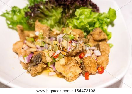 Delicious deep fried sea bass spicy salad