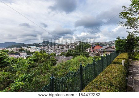 Nagasaki city skyline from top of the hill of Minami-Yamate